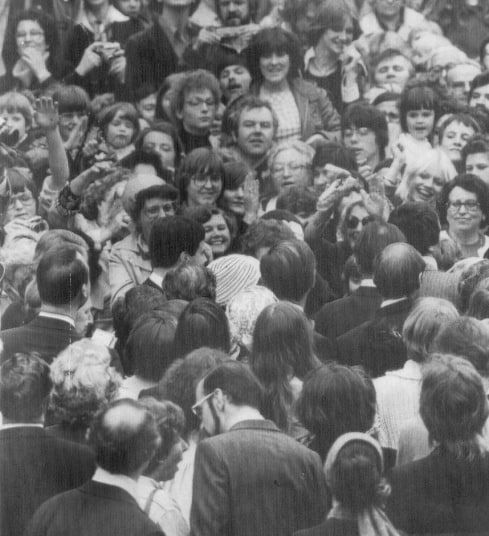 Spot head-dress in the crowd, thats all that can be seen of The Queen as thousands of West Germans press forward to glimpse or to touch her Majesty, as she walks the streets of Bonn during her 1978 visit