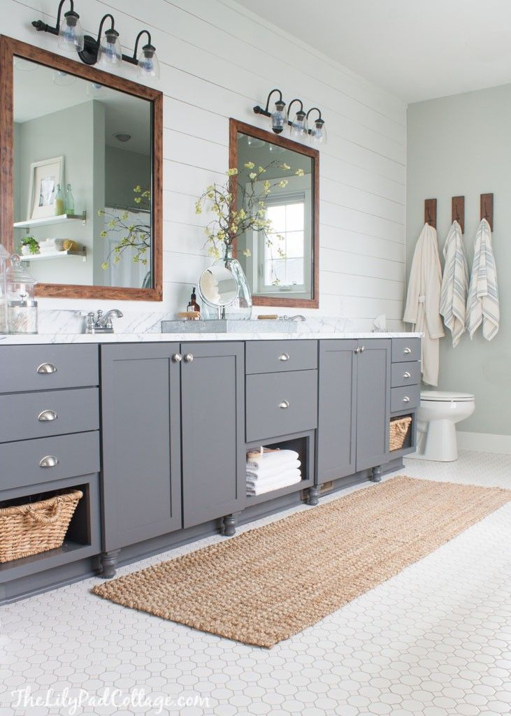 Lake House Master Bathroom. It's darling! Beautiful farmhouse colors and shiplap wall!