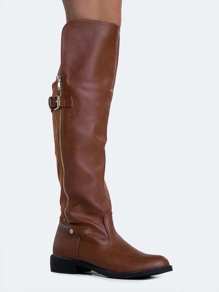 - No one will ever guess what a great deal you got on these super lavish, riding boots! - Knee high boots have a goldtone zipper on the side with a stretchy lycra panel in the back for the perfect fit