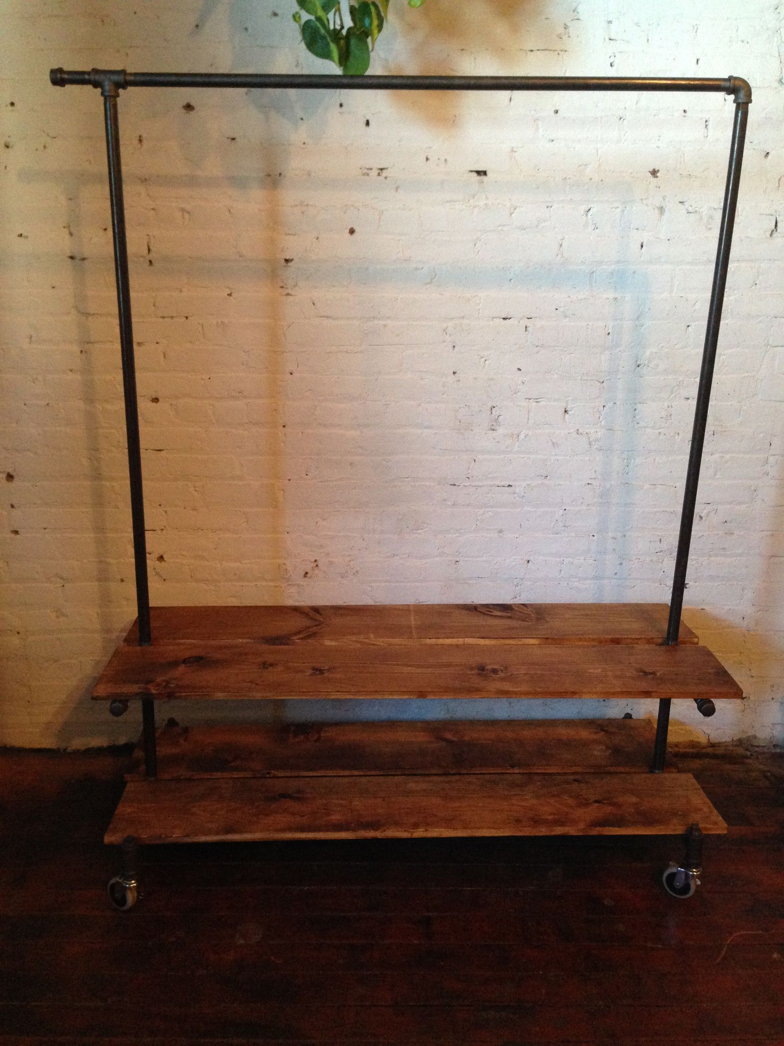 Industrial clothing rack with shelves shelving wheels and storage
