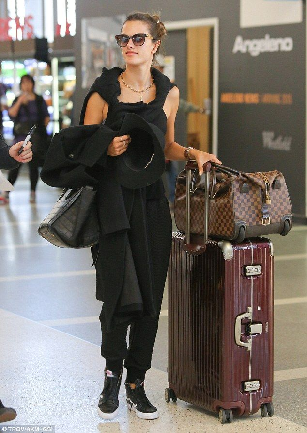 Chic traveler: Alessandra looked trendy as she pushed Rimowa designer luggage through LAX ...