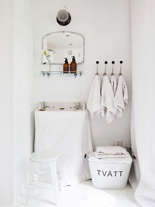 Great idea for a petite bathroom or laundry reno with a few light accessories, covers and blinds. Tres chic.