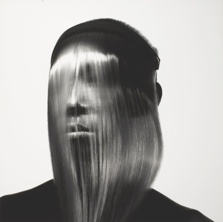Issey Miyake Fashion: Face Covered with Hair  Copyright The Irving Penn Foundation