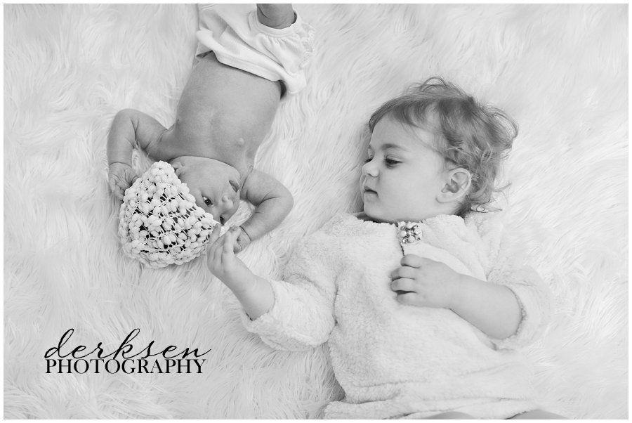 Newborn baby sibling poses