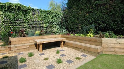 sleeper retaining wall railway sleeper garden design loughton - Garden Design Using Sleepers
