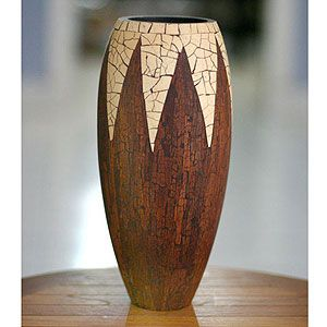 $61.99 Novica Cinnamon Snowcone Coconut Shell Vase. This is literally made out of cinnamon sticks and coconut shell!