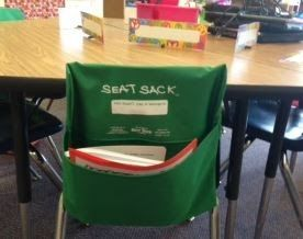 I am also super excited about my seat sacks and name tags. (The tags are on springs so that they stand up.  I hate taping them to the desks!)  They are perfect with the colors in my room!