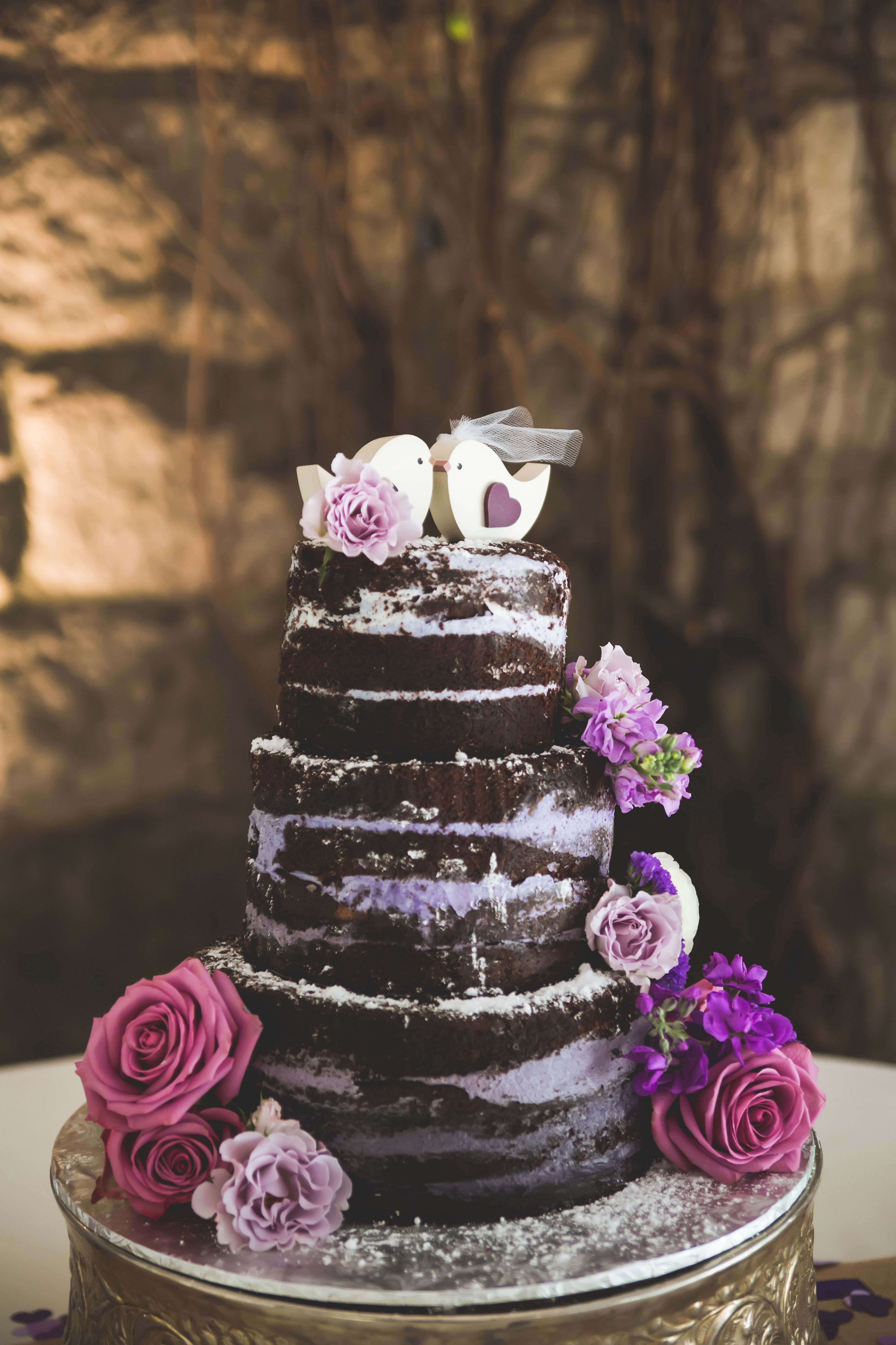 aaa598921f12 Naked Chocolate Wedding Cake With Purple Filling... Don't like the topper  but the purple looks good!!