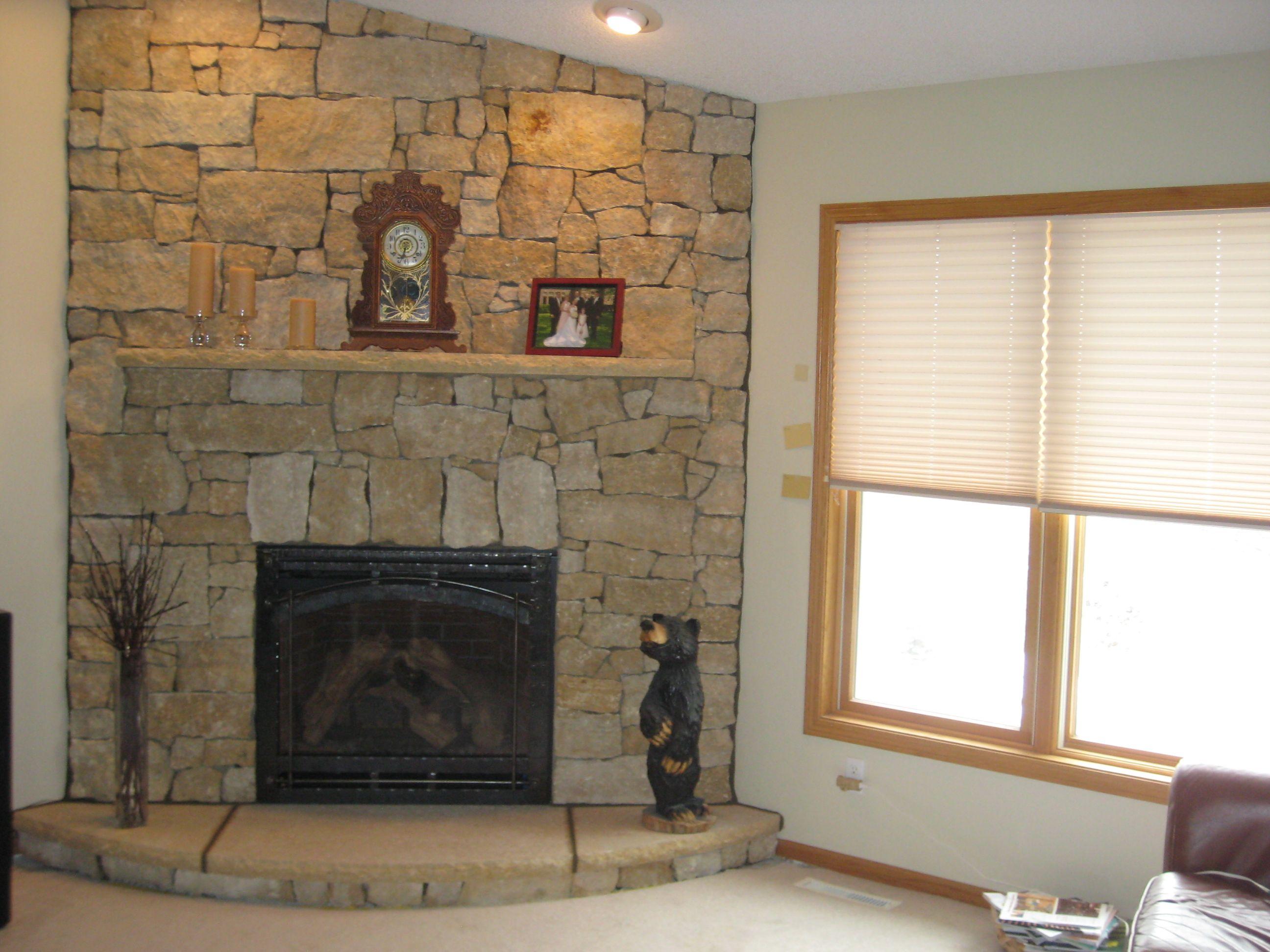simple corner fireplace using random ashlar split face fireplaces