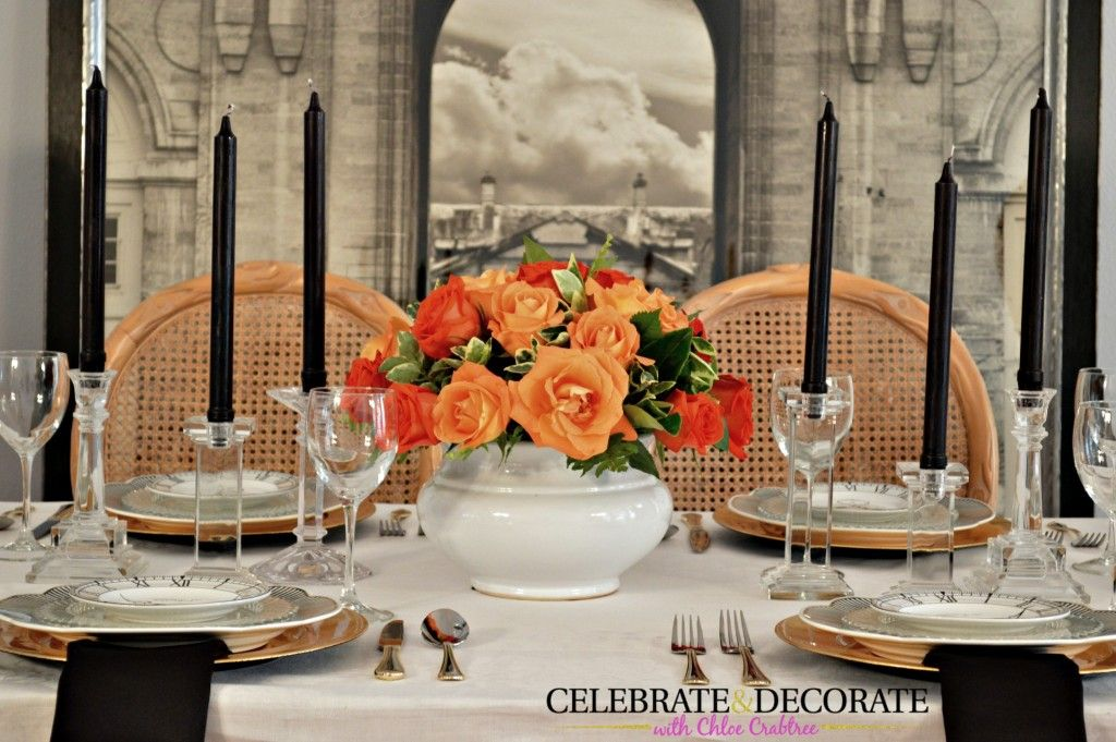 Orange rose centerpiece and black candles.