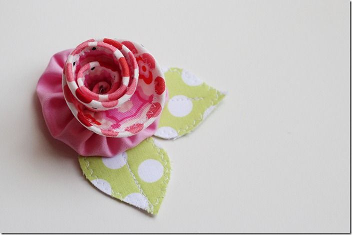 We all know that embellishments are what take something good and make it something great. This book has 25 DIY fabric flower projects that will give something an extra oomph! For my stop on the tour, I chose to make the Bias Bloom! A great scrap-busting project.