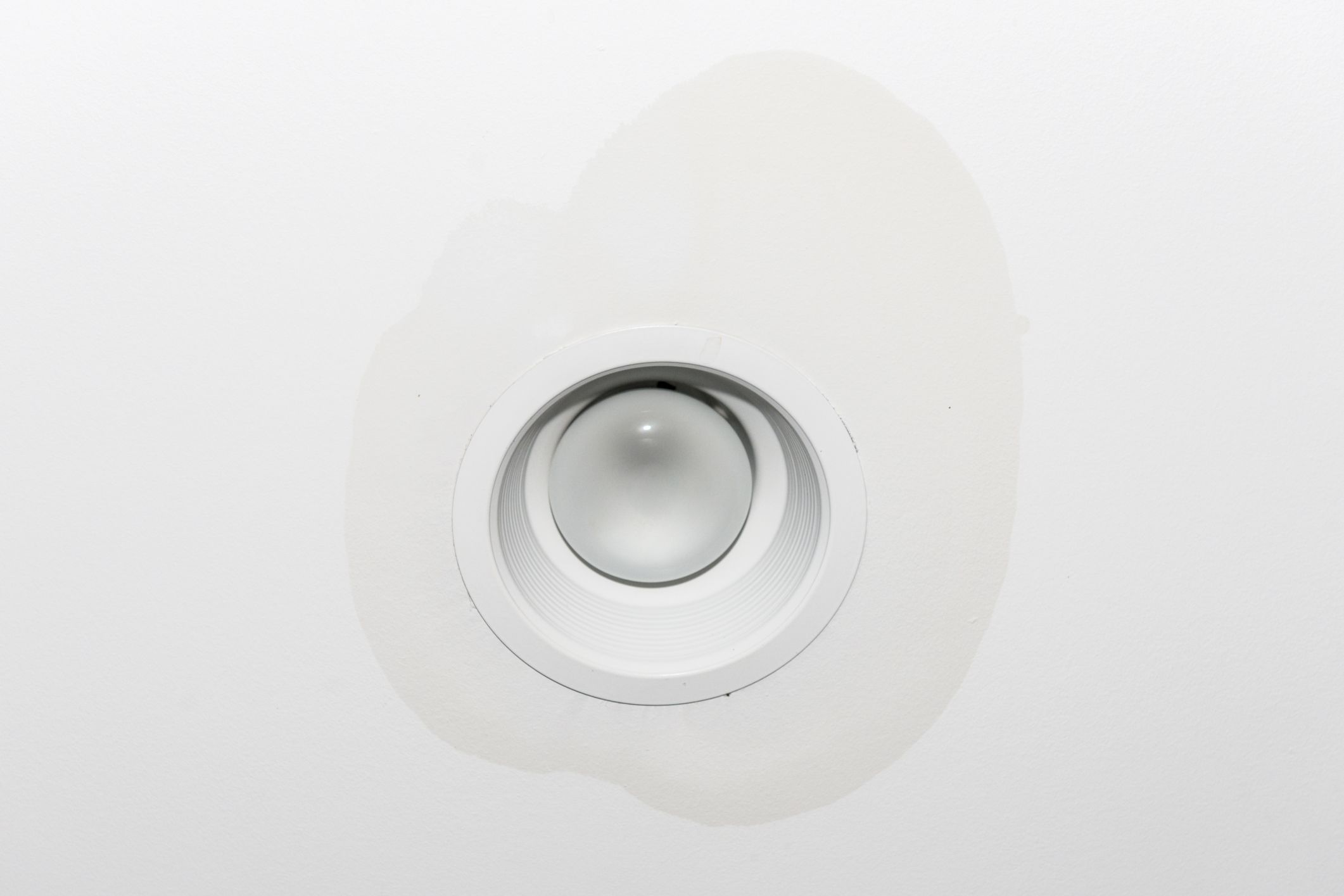 Water Damage Around A Light Fixture On A White Ceiling Ceiling Leak Light Fixtures Fixtures