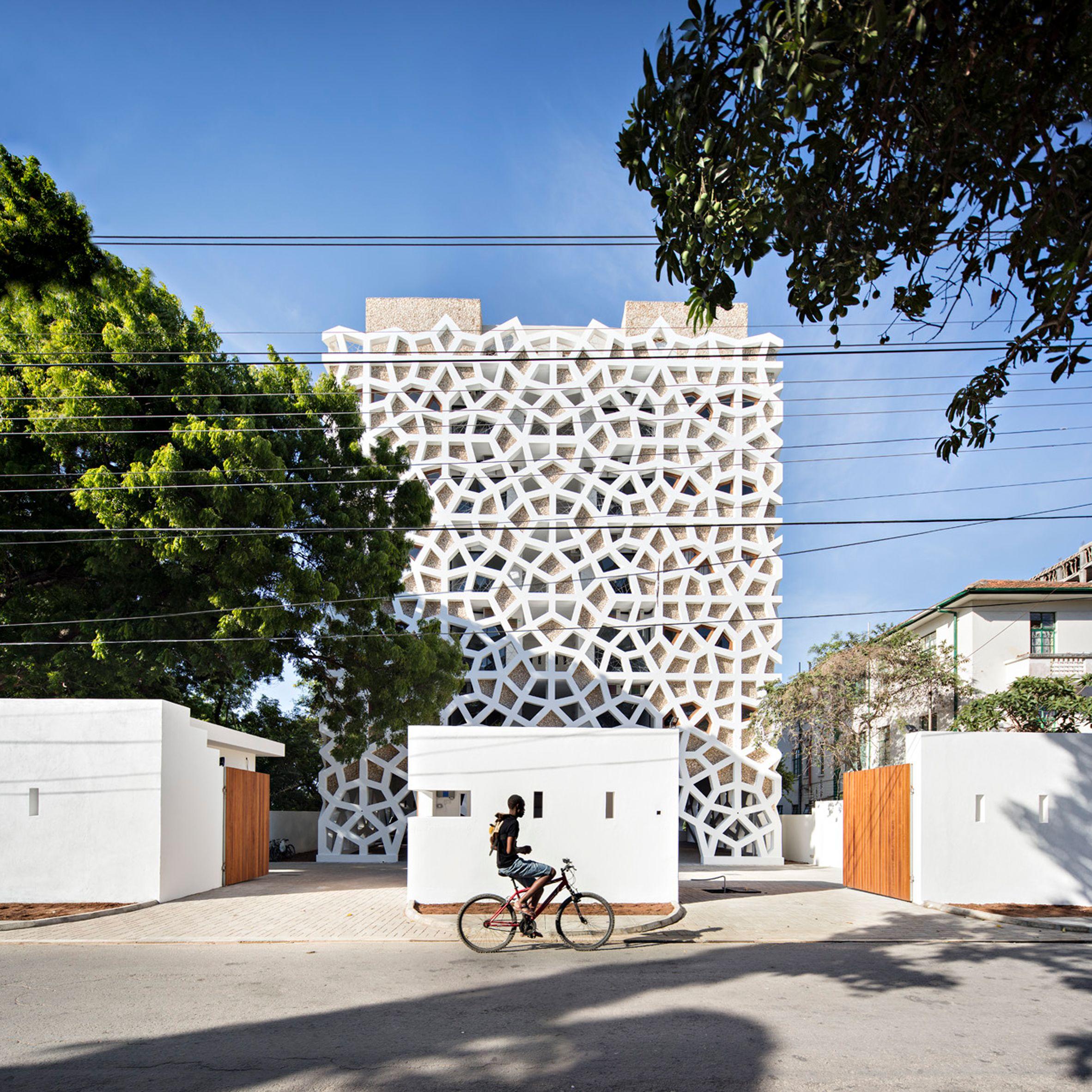White mashrabiya-style screens cover this apartment block in Mombasa ...