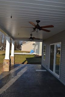 covered back porch with stamped concrete and fans. | dream ...