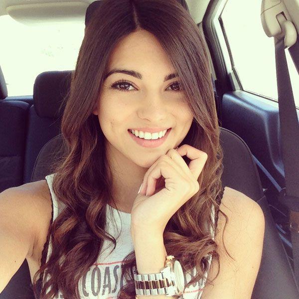cute brunette in a car get good skin too - read http://skincaretips