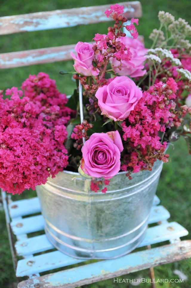 loose bunch of monochromatic flowers in a pail.  heavenly centerpiece - stick it on a chair to the side, perfect.