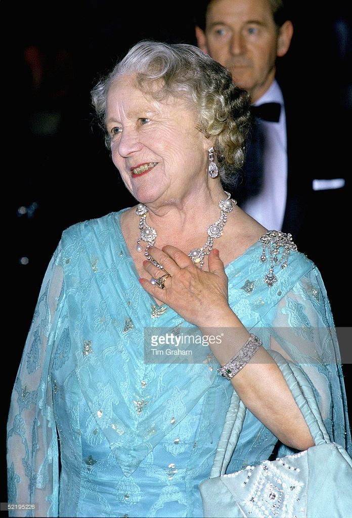The Queen Mother at an evening engagement wearing the ring