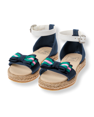 102f8bfdc7ded Striped grosgrain ribbon bow adds a preppy touch to our espadrille sandal.  Detailed with contrast buckle ankle strap.