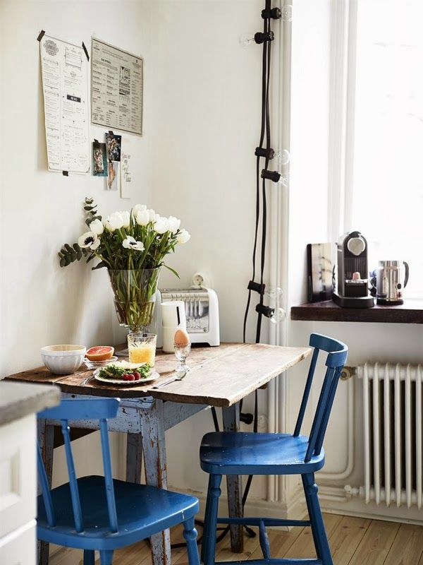 Love these bright blue chairs in this small but functional French ...
