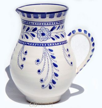 Handmade Large Ceramic Pitcher, Azoura's blue and white floral design is our version on a classic and timeless Mediterranean palette. Blue & white is one of the most popular color in our handmade dinner ware collection from Tunisia. As each piece is painted freehand, every piece will be slightly different.