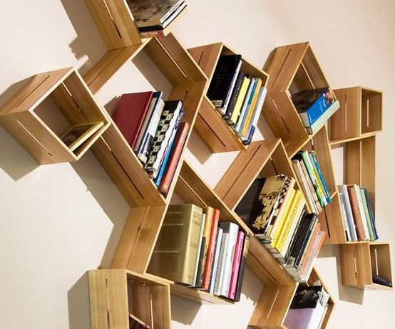Asymmetrical Shelving System Create An Abstract Work Of Art Thatll Help Keep Your Pad Organized With Th Unusual Bookshelf Unique Bookshelves Bookshelf Design