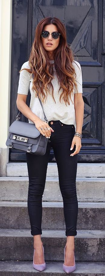 Negin Mirsalehi is wearing a top from Karen Millen, black jeans, pink shoes from Gianvito Rossi and a grey bag from Prouza Schouler