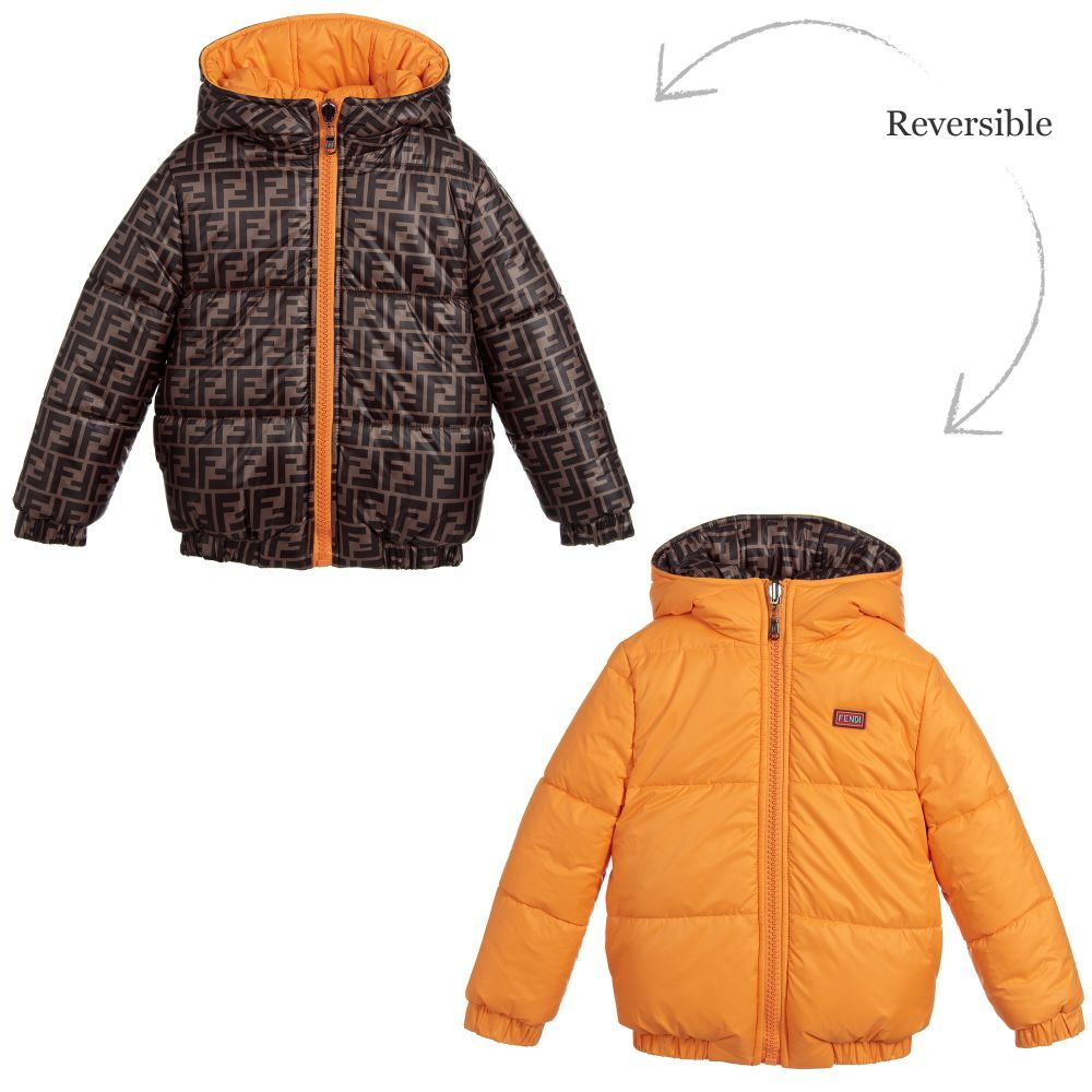 9600becf4 A warm and generously padded, reversible puffer jacket for both boys and  girls by Fendi. The brown side is patterned with the designers repeated  logo, ...