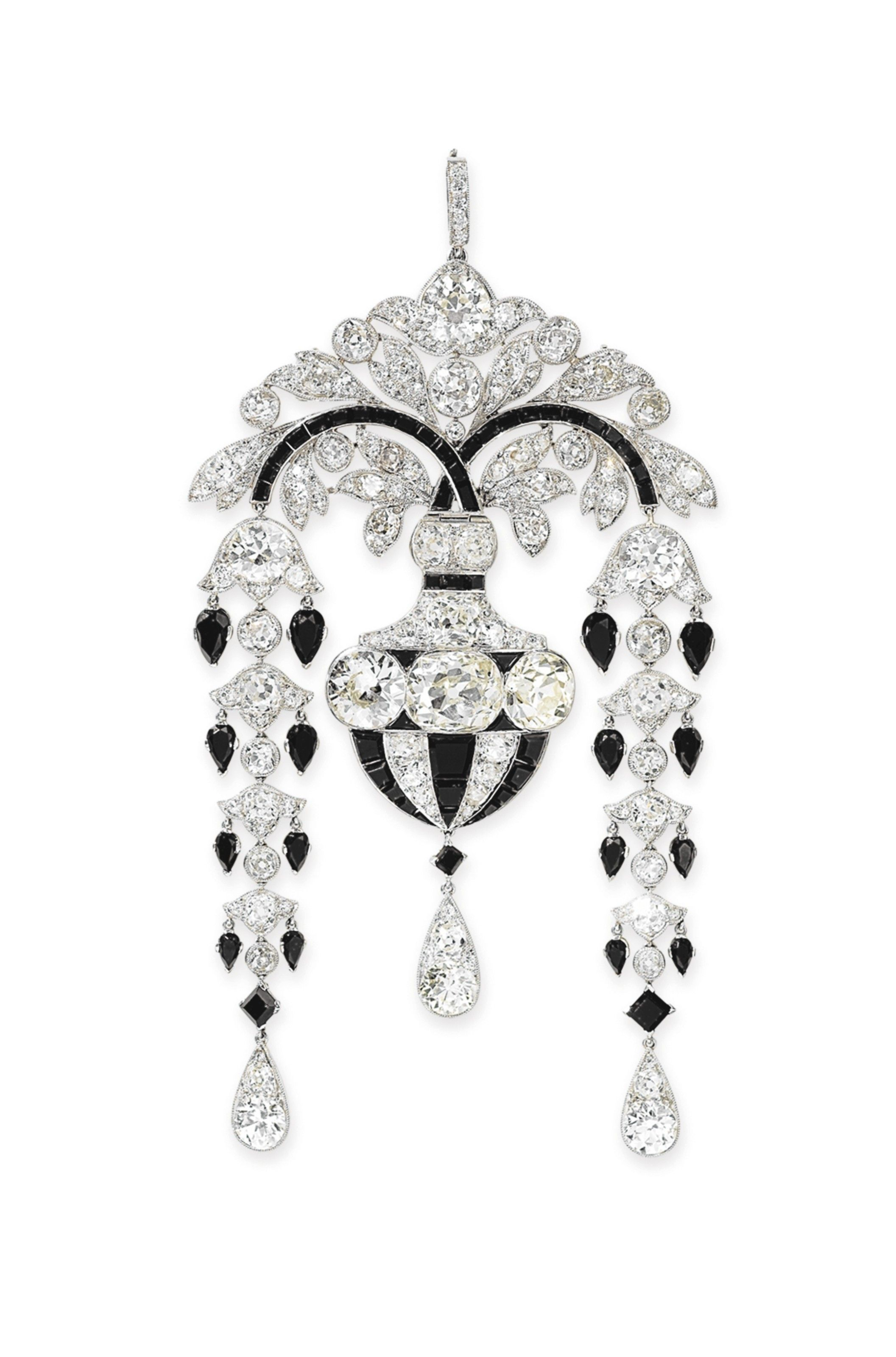 An Exquisite Art Deco Diamond And Onyx Pendant Brooch By