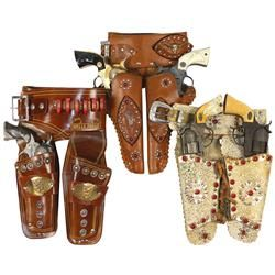 Toy cap guns & holsters, fancy leather holster w/rivets & jewels w/Cowboy cap guns, Wells Fargo leat