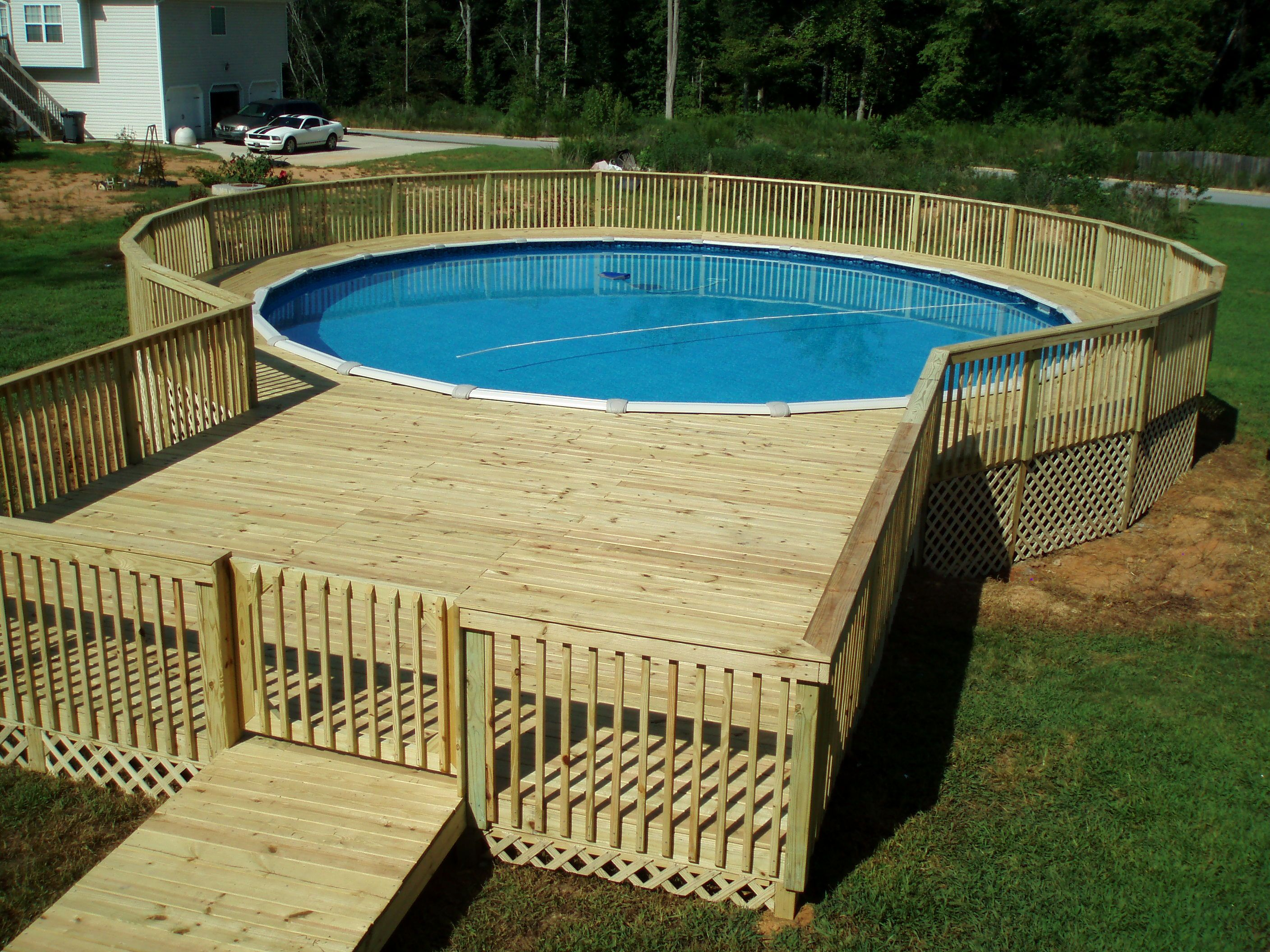 Pool decks above ground pictures - Many People Think That Building A Swimming Pool Will Make Our House More Narrow Area Above Ground