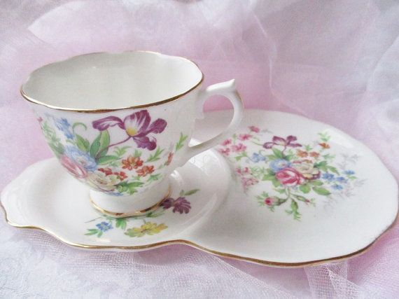 a royal albert snack set for one features a bone china teacup on a snack