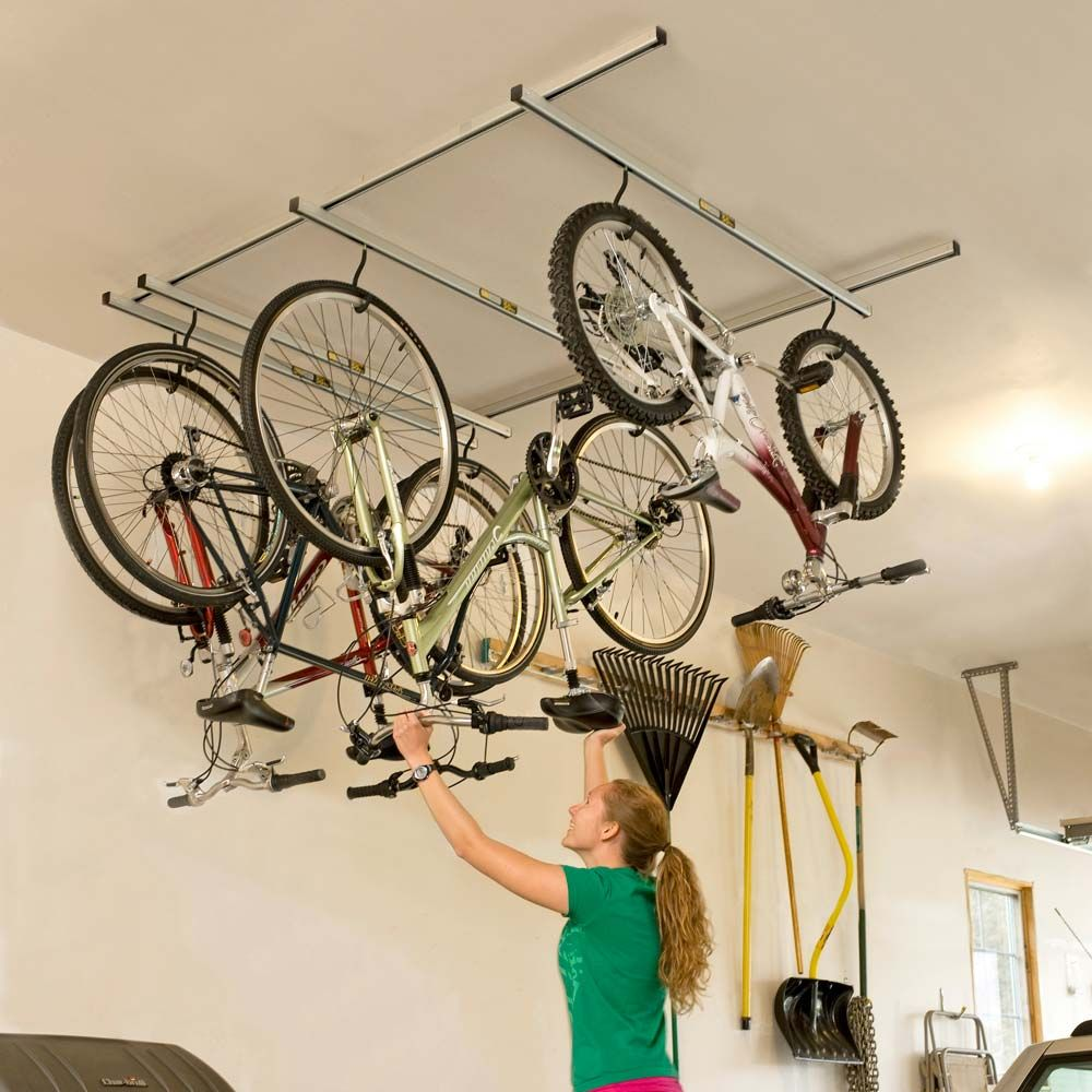 Hanging Bicycles From The Rafters Is A Great Way To Save Garage Space But Even Hanging Bikes Can Take Bike Storage Bike Storage Solutions Bike Storage Garage