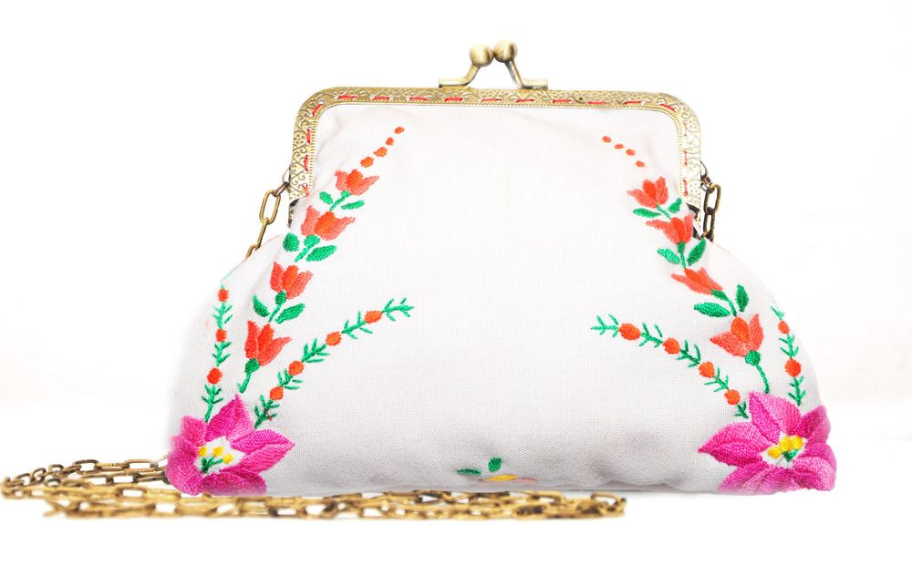 Kalocsai embroidery fabric is the front size, red polka dots fabric is the back side of this little clutch bag. There is fleece between the lining and outside fabric.As needleworks are never the same there might be a bit of difference in the flower pattern. But I will send you photos so that you can see the embroidery in advance.Size: 13 x 19 cm