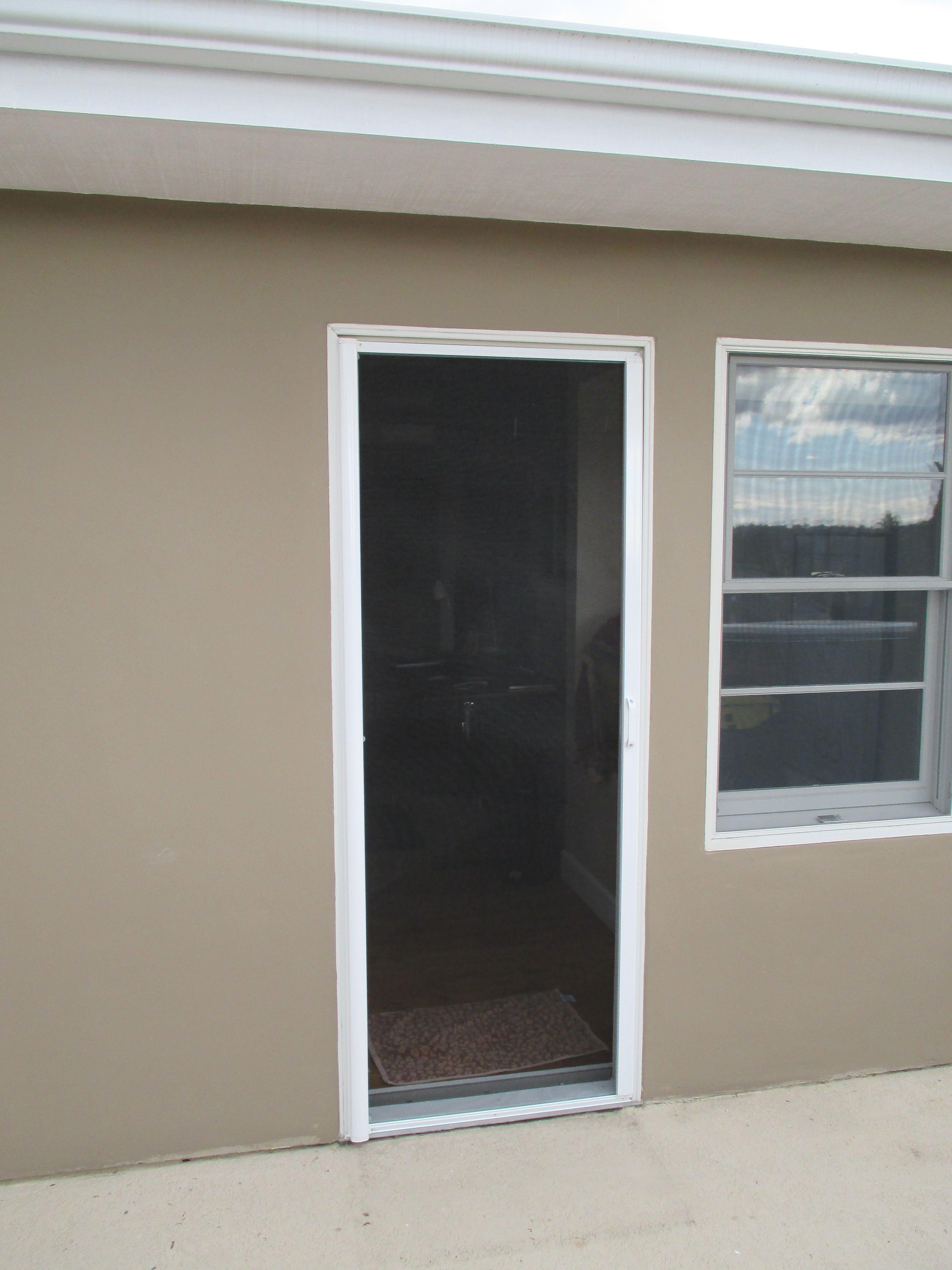 Single White Stowaway Retractable Screen Door With Black Fiberglass Mesh Just Installed On Upstairs Balcony Door Single French Door Balcony Doors Single Doors