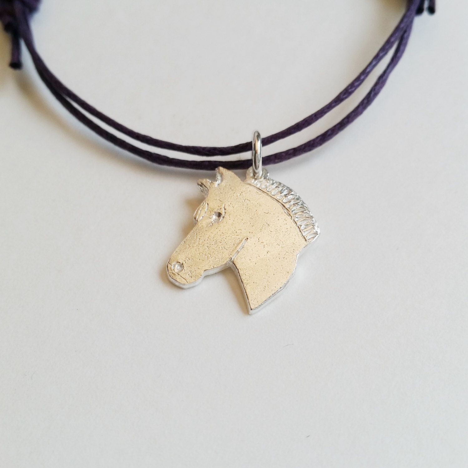 solid silver horse charm on cotton braid adjustable silver charm