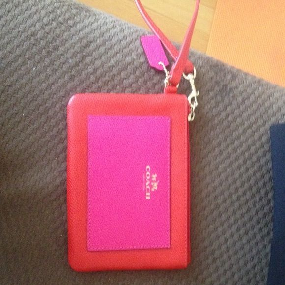 Coach Wristlet Orange and hot pink Wristlet; perfect for summer! Brand never never used Coach Bags Clutches & Wristlets