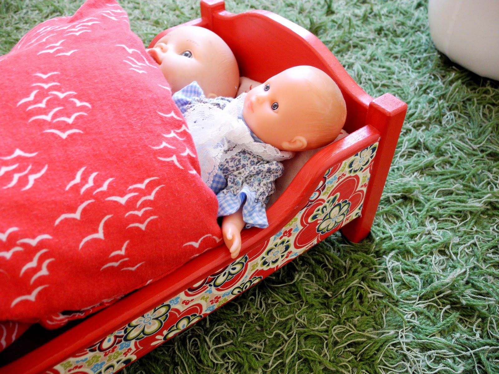 Paint and decoupage make this plain wood doll bed pop.  babyramen: DIY