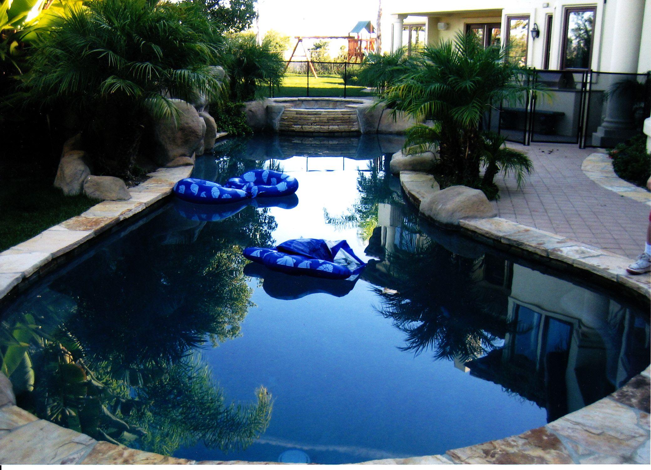 Black bottom salt water pool with rock waterfall built for Water pool design