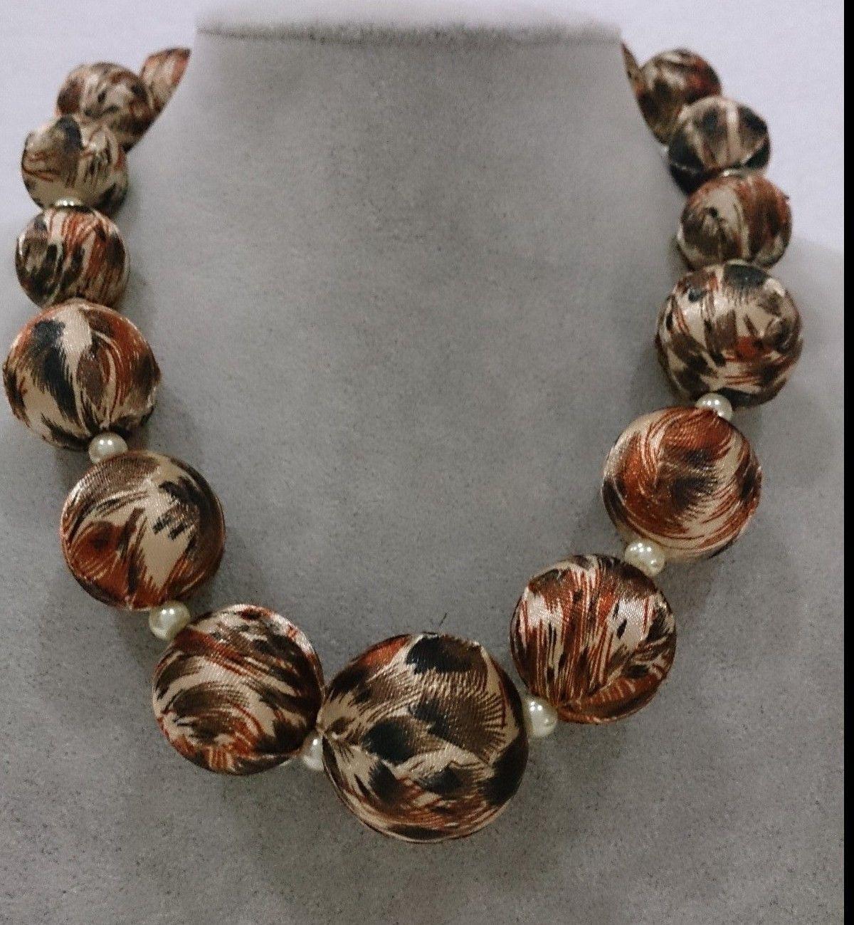 perlas forradas en tela animal print
