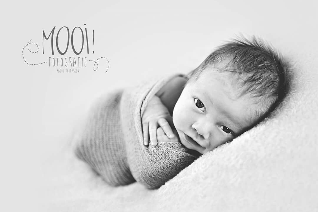 Newborn photography little 12 days old newborn baby wrapped captured in my home studio