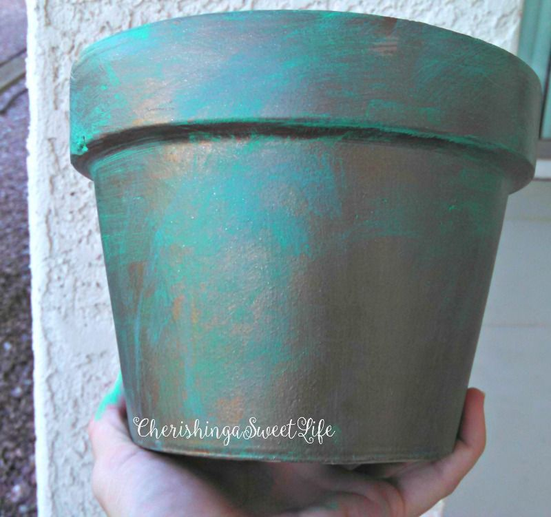 DIY Faux Patina Flower Pots is part of Flower pots, Diy flower pots, Flower pots outdoor, Clay pots, Large flower pots, Container gardening - As I was planting more basil and peppermint, I looked at my old clay pots, and I knew they needed more color! I love the shades of turquoise patina has, so I decided to paint a faux patina  I went out and bought 4 acrylic paints  Metallic chocolate brown from Folk Art Turquoise Bimini Blue Spring Green from Apple Barrel First, I completely rinsed out all the debris out of the clay pot, and let it completely dry  Then I painted the entire outside of the pot with the Cho…