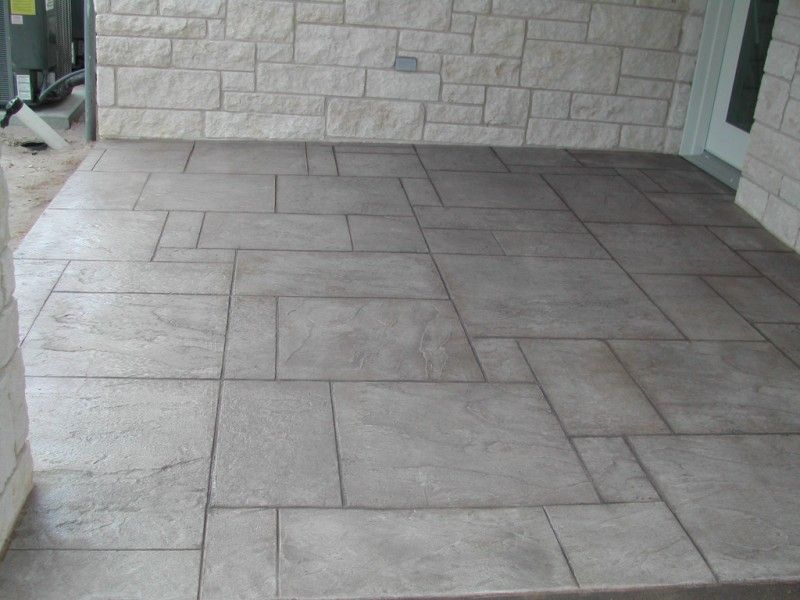 Stamped concrete patio floor hmmm not a bad idea for Concrete floor covering ideas