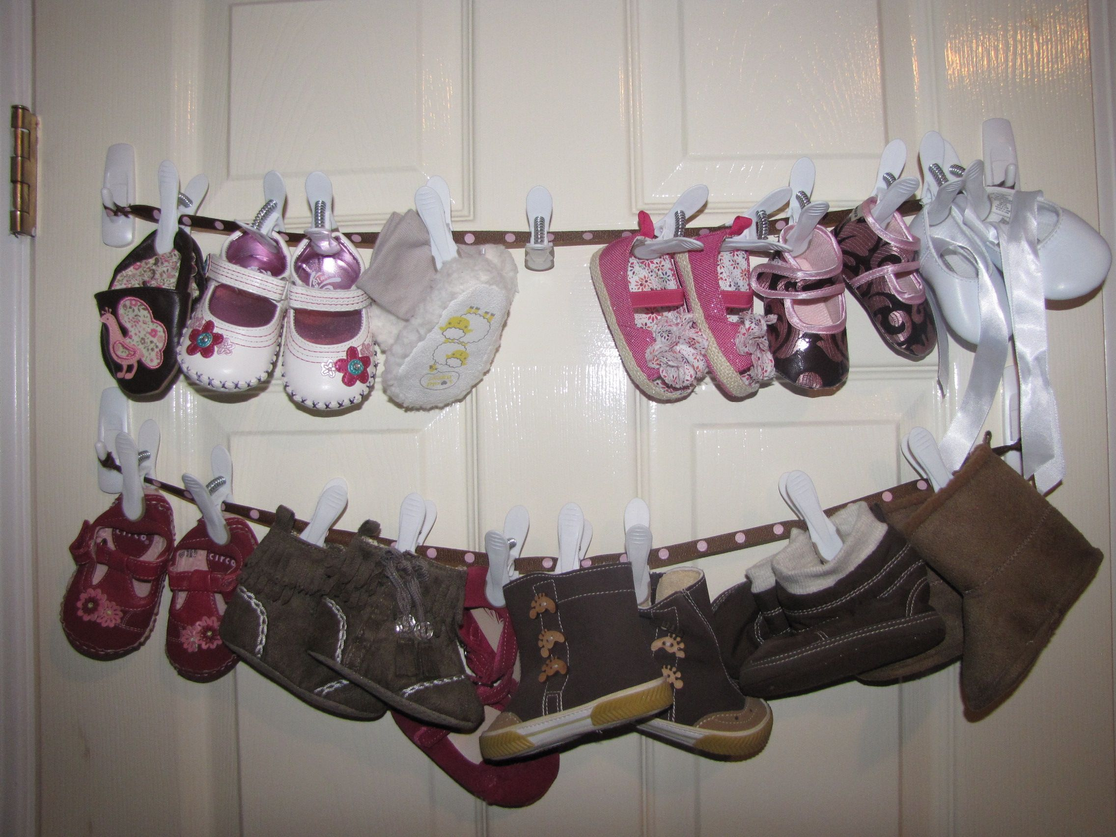 Baby shoe storage 3M hooks ribbon and clothes pins on the back of