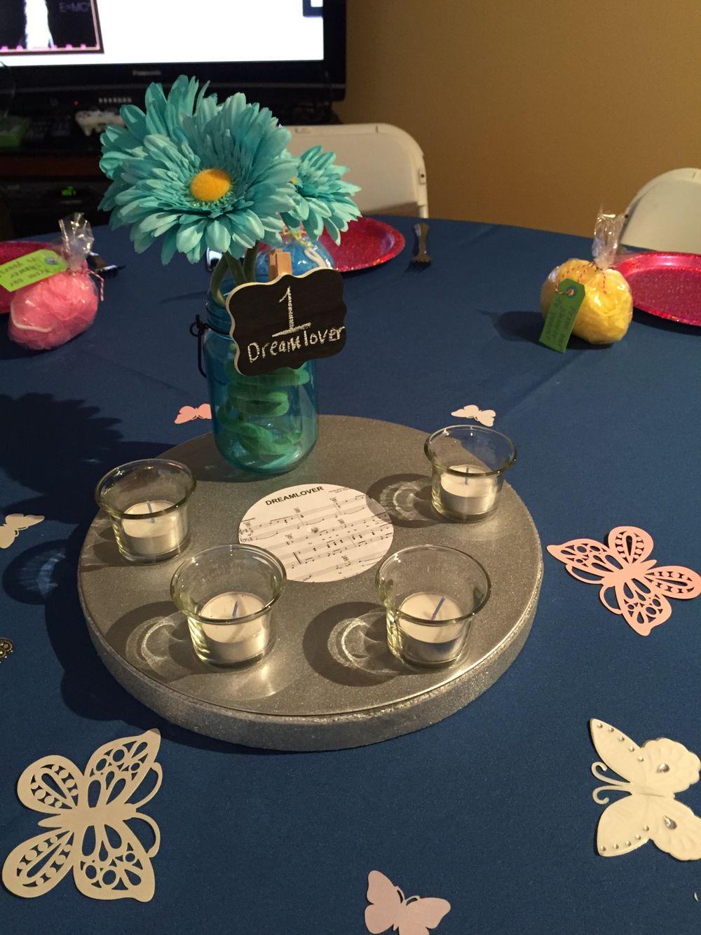 """Blue centerpiece for Mariah Carey themed bridal shower featuring """"Dreamlover"""" sheet music."""