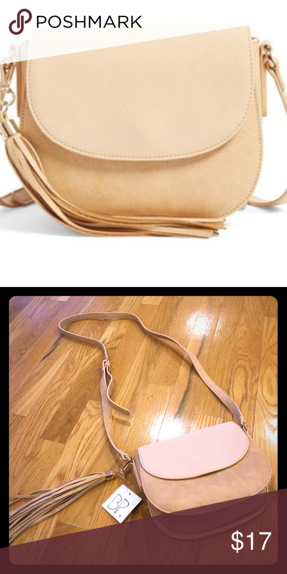 BP Saddle Tassel Crossbody Bag NWT A chic scaled back saddle bag silhouette and swingy tassel charm make this faux leather bag a stylish everyday companion.  Magnetic snap clap closure.  Adjustable strap. Options tassel. Interior zip, wall and smartphone pockets. Lined. Polyurethane. BP brand. BP Bags Crossbody Bags