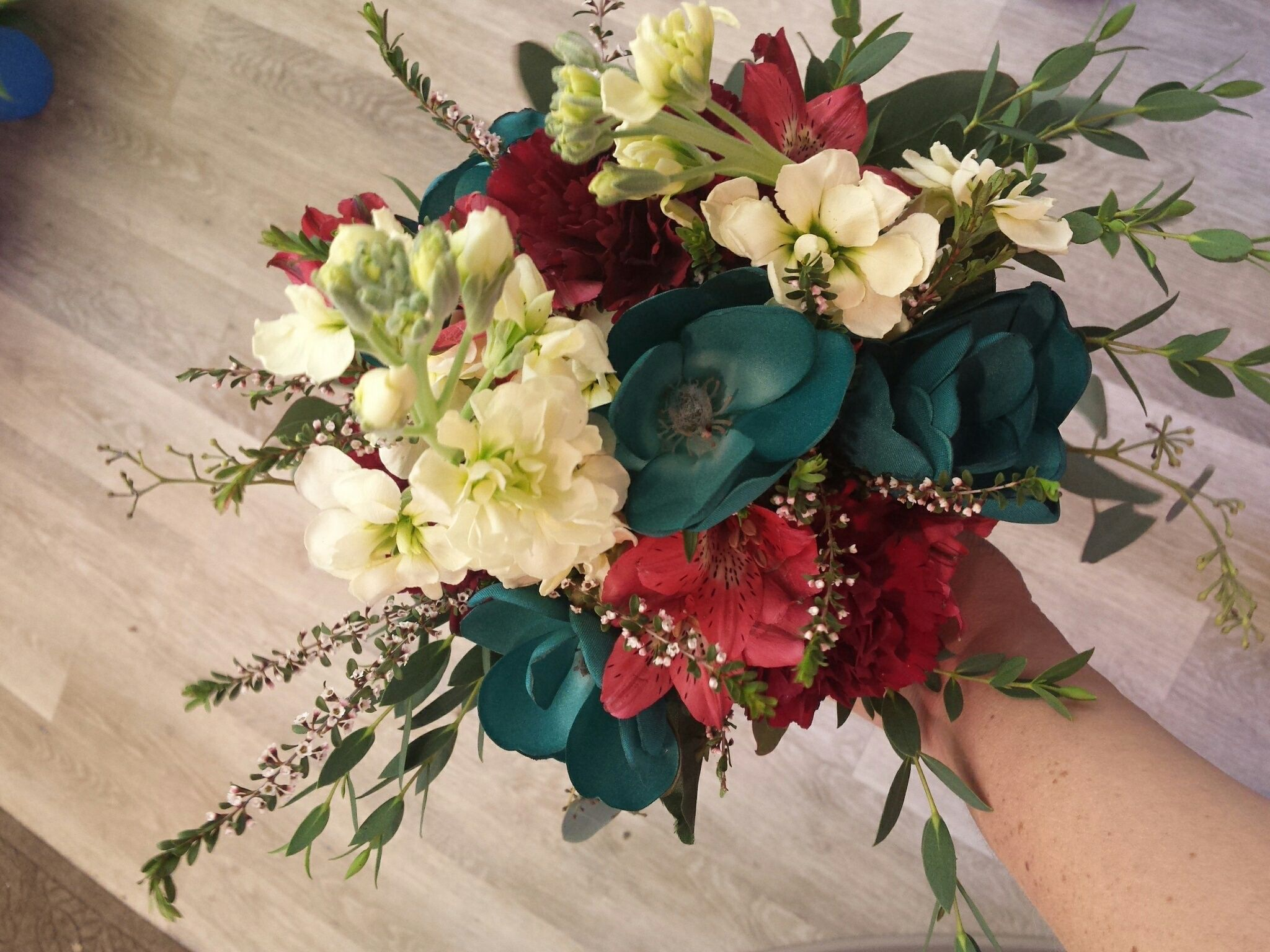 Burgundy And Teal Bouquet Featuring Teal Permanent Flowers Cream Stock Burgundy Alstromeria And Sterl Teal Wedding Flowers Prom Flowers Bouquet Teal Bouquet