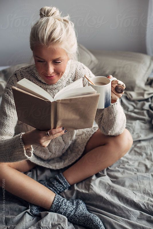 Smiling Caucasian Woman Reading A Book And Drinking Coffee -7963