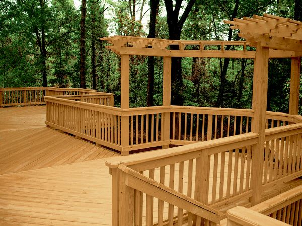 Midwest Manufacturing Deck Made Of Cedartone Decking Looks Like Cedar But Is Actually Treated Lumber Will Hopefully Last House Exterior Outdoor Decor Wood