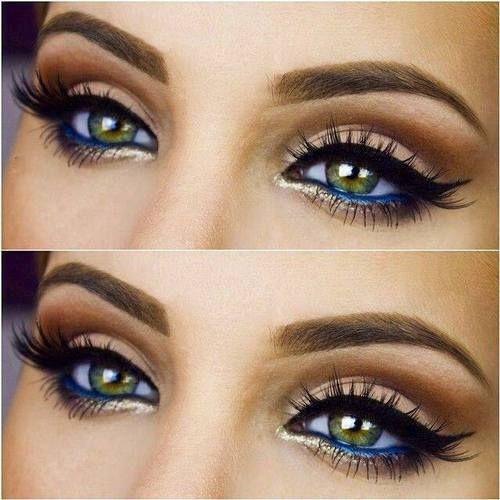 Beautiful eye makeup! gold highlight blue eyeliner bold black eyeliner & brows. I love this look!~Am
