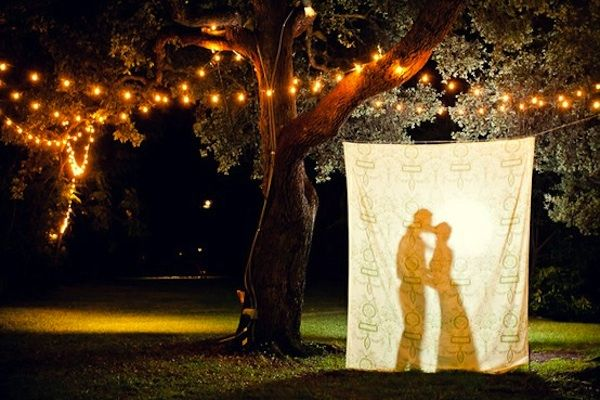 One of the easiest, most affordable, and fun photobackdrops is…a sheet. Yes, I know, it sounds too simple to be true, but just searching on ebay oretsy for a colorful vintage sheet can yield all kinds of amazing finds. I especially love thislook for outdoor weddings, and look how great it can be even at night! Simple, sweet, affordable, it's the best kind of DIY! Just search, click, buy and hang with a string. The same look can be attained with an anthropology shower curtain or just…